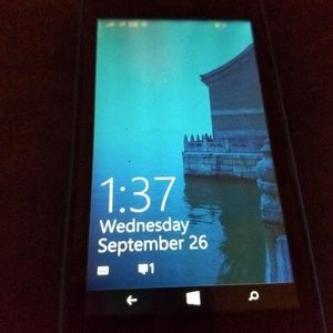 Nokia Lumia Cricket with blue case, missing part
